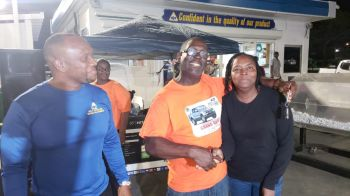 Winner of the Ford Ranger XTL, Muriel Penn, right, is congratulated by Deputy Police Commissioner Alwin James, centre. Photo: VINO