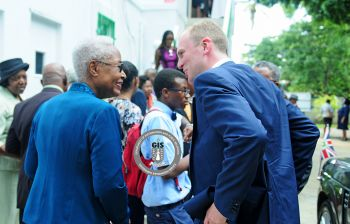 Magdaline Rhymer, left, seen here with Governor Augustus J. U. Jaspert, right, in August 2017, served on the Public Service Commission for almost 8 years. Photo: GIS/File