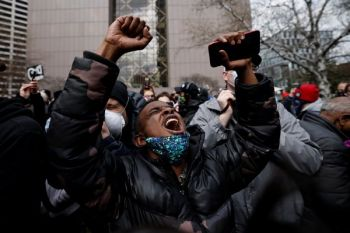A person reacts after the verdict in the Derek Chauvin trial is announced in front of Hennepin County Courthouse in Minneapolis Tuesday, April 19, 2021. Photo: Carlos Barria/Reuters