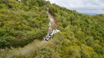 The concrete truck was seen on its left side close to the hillside of a narrow road. Photo: Team of Reporters