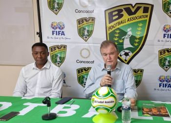 Mr Christopher M. Kiwomya, left, is introduced to the public as the new national coach by President of the BVI Football Association Mr Andrew D. Bickerton, right, today, October 8, 2021. Photo: VINO