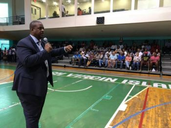 Premier and Minister of Finance Honourable Andrew A. Fahie (R1) addresses the audience at the Clear Path to Regularisation meetings, which began on May 13, 2019 at the Multi-Purpose Sports Complex in Road Town, Tortola. Photo: Facebook/File