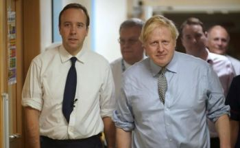 United Kingdom (UK) Prime Minister Alexander Boris de Pfeffel Johnson, right, who gave the former VI Governor Augustus J. U. Jaspert a job on his return to the UK, had been under fire for his refusal to sack disgraced former Health Secretary, Matthew J.D. Hancock, left, for breaking COVID-19 guidelines as soon as pictures emerged of him kissing an aide. Photo: Internet Source