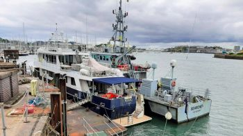 The Kahu seen docked beside Border Force's cutter Searcher. Photo: NCA