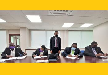 Seated from Left: Flow Corporate Sales Manager Marlon Solomon, Country Manager of Flow Ravindra Maywahlall, Premier's Ministerial Advisor Kevin C. Smith and Premier and Minister of Finance Hon Andrew A. Fahie (R1) at the contract signing to rebuild the CCTV network destroyed during the hurricanes of 2017. Standing is Director of Projects Dr Drexel M. Glasgow. Photo: RVIPF
