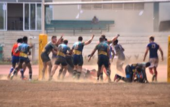 What's a rugby game without the drags and dust rolls! Photo: Charlie E. Jackson/VINO