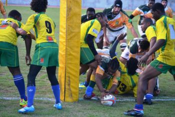 Donovan Staples scores late on to give the VI some hope of snatching a late victory in the 24-22 loss to SVG. Photo: Charlie E. Jackson/VINO