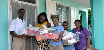 Jaleel F. Cameron and members of the Jaleel Cameron Foundation recently donated school supplies to the Rainbow Children's Home. Photo: Team of Reporters
