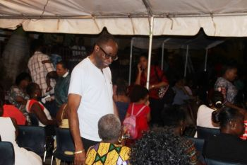 Third District Representative and Opposition Leader Hon Julian Fraser RA greets persons at the Ebenezer Thomas Primary School's Christmas concert on December 6, 2016. Photo: VINO