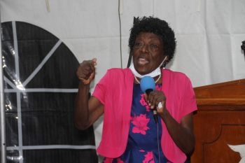 Pastor at the Agape Total Life Centre, Dr Lucia C. Woods ministering to the prisoners. Photo: VINO