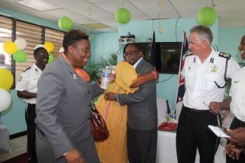 Opposition Leader and Third District Representative, Hon Julian Fraser RA gives a congratulatory hug to Superintendent of Police, Jacqueline E. Vanterpool. Photo: VINO