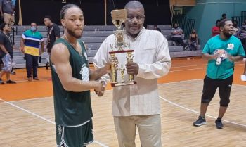 President of the BVIBF Mr Derrick R. VarlackMVP presents the award for the Senior Division MVP to Kimron S. Telemaque of the Bayside Blazers. Photo: Team of Reporters