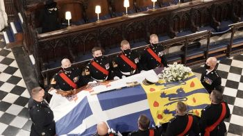 The Queen watches as the coffin is placed in the chapel, ahead of the service. Photo: Sky News