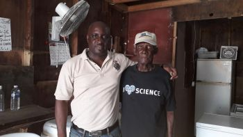Thomas C. Famous, left, with a resident of Tortola on his recent visit to the Virgin Islands. Photo: Provided