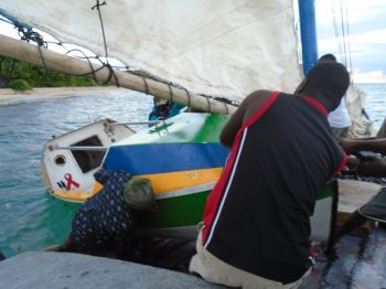 The Spirit of Malabo boards Ms. Diana for a 40 nautical mile tow from Turtle Island, Haiti to the Port of Cap Haitian. The Brazilian built ocean rowboat arrives this week in Miami by Haiti Shipping Lines. Photo: Provided
