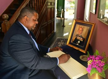 Virgin Islands Premier and Minister of Finance, Hon Andrew A. Fahie signs the book of condolences in honour of Prince Philip. Photo: Team of Reporters