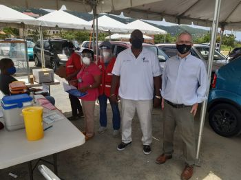 H.E. John J. Rankin stands alongside VI Minister of Health and Social Development, Hon Carvin Malone at the first COVID-19 vaccination drive-through initiative in the Virgin Islands. Photo: Team of Reporters