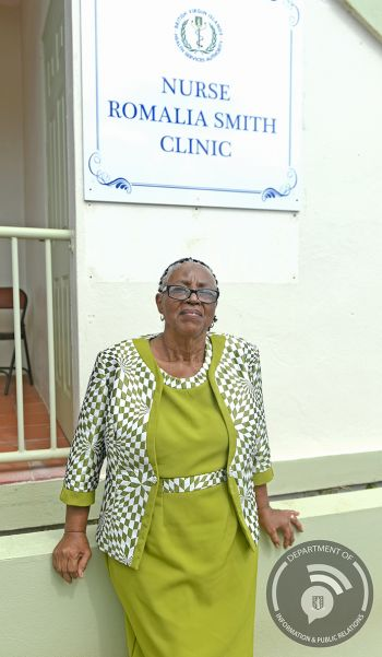 Nurse Romalia Smith poses in front of the newly renamed clinic in her honour. Photo: GIS