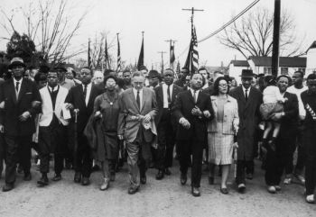 John R. Lewis (second from left) joins American civil-rights campaigner Martin Luther King Jr. and his wife Coretta Scott King in a march from Selma, Ala., to the state capital in Montgomery on March 30, 1965. Photo: William Lovelace—Express/Getty Images