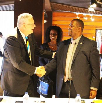 Premier and Minister of Finance, Honourable Andrew A. Fahie greets and speaks with Prime Minister of St. Lucia, Allen Chastanet during the OECS Authority Welcome Breakfast Meeting. Photo Credit: Bria Smith/GIS