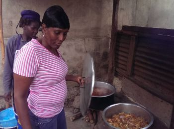 Izene cooking curry goat for workmen. Photo: Provided