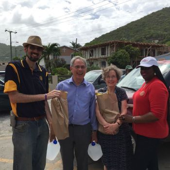 This visiting British couple was moved by the initiative taken for Dominica. They were thanked by Ms Lynette L. Harrigan on behalf of the BVI Tourist Board (BVITB) and Mr Ryan Geluk, President of the Rotary Club of Road Town. Photo: VINO