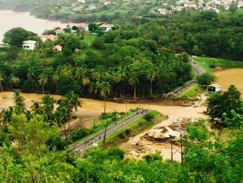 A section of a roadway in Dominica washed away due to tropical storm Erika. Photo: Facebook