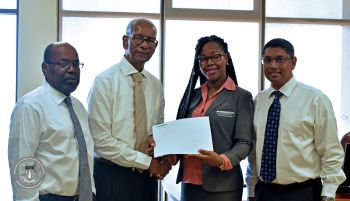 Premier and Minister of Finance, Dr The Honourable D. Orlando Smith, OBE today, April 19, 2018 accepted a cheque for $11.4 million on behalf of his Government from NAGICO Insurance for a claim settlement following the damages to the buildings caused by hurricane Irma. Photo: GIS