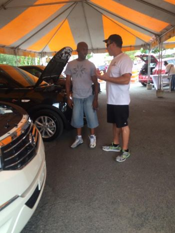 A potential customer learns about the new brand of vehicles now available at Nibbs Auto Sales and Parts. Photo: Facebook