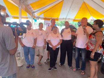 Staff members of Nibbs Auto Sales and Parts speak to the media at the launch of SsangYong Motors franchise at Sunny Caribbee parking lot in Road Town on November 19, 2016. Owner of Nibbs Auto Sales and Parts, Mr Leando Nibbs is 3rd from right. Photo: Facebook