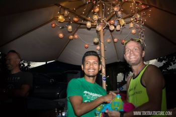 Stoby (left) collects his winning prize, a fuel belt, from Richard Morgan. Photo: Tortola Torture/Facebook