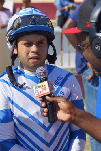 Champion Jockey Bryant Gonzalez is interviewed after riding Gottcha Blessin to victory. Photo: Andre 'Shadow' Dawson/VINO