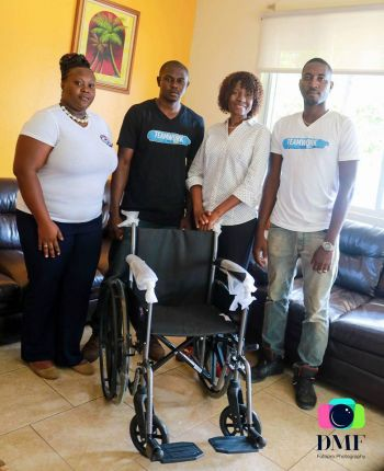Members of Teamwork Family Entertainment donated a wheelchair to the Adina Donovan Home for the Elderly on April 26, 2017. Photo: TWF