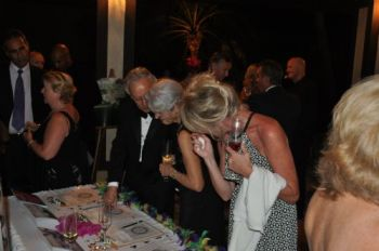 A scene from last year's dinner and auction. Photo: VINO/File