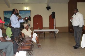 Back in May 2015 Mr Collinson George was applauded when he called for Josiah's Bay to remain as a residential area, while the elderly woman seated in front row blasted politicians for allegedly only caring about money. Right is Chief Planning Officer Mr Gregory W. Adams. Photo: VINO/file