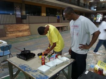 Denfield D. Solomon, who used to work at Peter Island Resort, came to the session to share his knowledge in the kitchen with the boys. Photo: VINO
