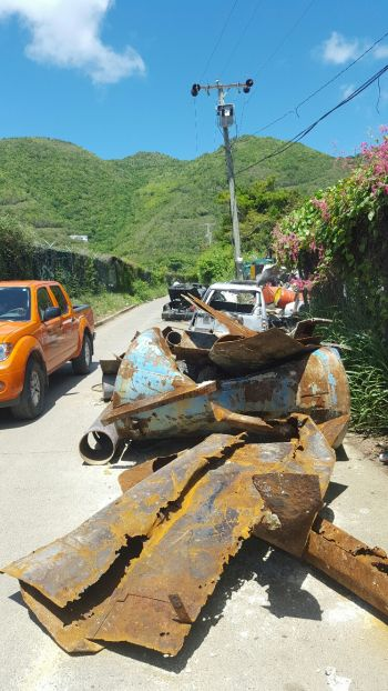 Debris all around making it difficult to use the road. Photo: VINO