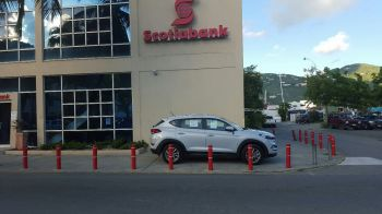 As its opening is imminent, the business is already getting its face out there in the form of its new vehicles on display on front of Scotiabank VI every business day with information on rates and conditions for financing posted on the vehicle windows. Photo: VINO