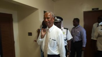 Premier Dr The Hon D. Orlando Smith being escorted by Acting Commissioner Alwyn James while touring the facility. Photo: VINO