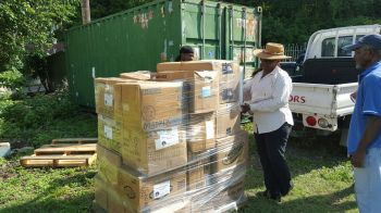 Wrapping the items in preparation for the journey to Dominica. Photo: VINO
