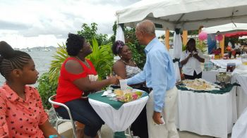 Premier Dr The Hon D. Orlando Smith greeting some of the patrons. Photo: VINO