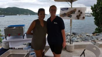 These two ladies of the Island Last Resort were only too happy to serve up samples of their food. Photo: VINO