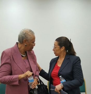 Deputy Governor V. Inez Archibald CBE (left) having a word with Permanent Secretary in the Ministry of Education Dr Marcia Potter. Photo: VINO