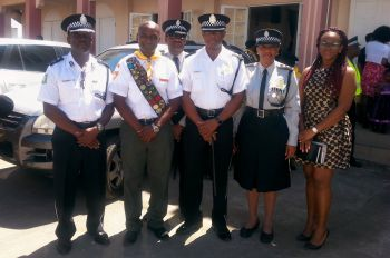 Acting Commissioner of Police Alwin James (far left) stands next to Pastor Howard Simon of the Seventh-day Adventist Church, other senior police officers as well as the chair of the Police Service Commission Fiona Forbes (far right) following the Police Week opening church service on Saturday February 27, 2016. Photo: Provided