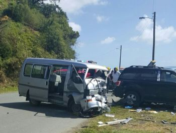 The damaged minibus that was transporting tourists at the time of the accident at Slaney today, January 15, 2017. Photo: VINO