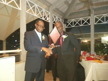 Former Leader of the Opposition and Third District Representative Hon Julian Fraser RA (left) receives his plaque from Pastor Howard Simon. Photo: VINO