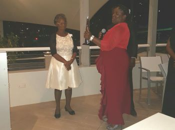 Retired teacher of the BVI SDA School, Mrs Veronica Melda McDowall (left) is presented with her plaque by Mrs Sharon Leonard. Photo: VINO