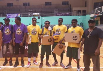 From left: Directors of K&J 3 on 3 Basketball Tournament Kennedy H. Bass and Jason A. Edwin, along with the winning Junior Bayside Blazers team of Nixon M. Hamilton, Jachoy M. S. Walwyn, Lestin S. Wiltshire, Devante A. Brewley and coach Nathaniel J. Malone. Photo: Team of Reporters