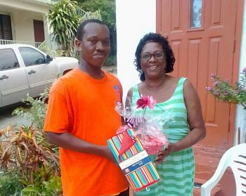 A senior mom receives a Mother's Day gift as part of the Gifted Hands Programme in the Sea Cows Bay community. Photo: Provided