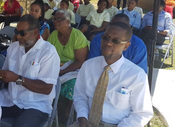 Deputy Secretary in the Ministry of Natural Resources and Labour, Mr Joseph Smith-Abbott, right, has been described as an unsung hero by Deputy Premier and Minister for Natural Resources and Labour, Dr The Hon Kedrick D. Pickering (R7). Photo: VINO